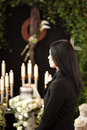 Woman at funeral mourning religion death and dolor urn the death of a loved person Royalty Free Stock Images