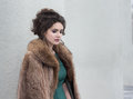 Woman in fur coat in her thoughts Stock Photo