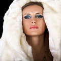 Woman in fur fashion glamour style photography sensual winter professional make up and expensive jewellery toned skin salon Stock Image
