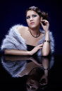 Woman in fur portrait of young beautiful brunette tippet and jewelry at mirror table Stock Images