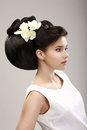 Woman with futuristic hairstyle and orchid charisma profile of independent flowers Royalty Free Stock Photography