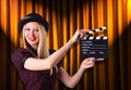 Woman gangster with movie clapper Stock Photography