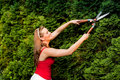 Woman in garden trimming hedge Royalty Free Stock Image