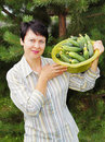 Woman-gardener with fresh cucumbers Royalty Free Stock Photo