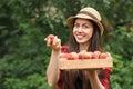 Woman gardener holding peaches