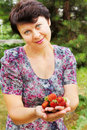 Woman-gardener holds strawberry Royalty Free Stock Photos