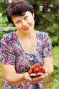 Woman-gardener holds strawberry Royalty Free Stock Photos