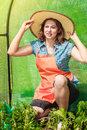 Woman with gardening tool working in greenhouse Royalty Free Stock Photo