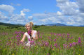 Woman Gathering Flowers on Summer Meadow Royalty Free Stock Photo