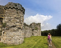 A Woman Gazes at Beaumaris Castle on Anglesey Stock Photography
