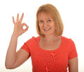 Woman gesturing ok a making a gesture with her index finger and thumb for Royalty Free Stock Photo