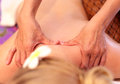 Woman getting back massage at a spa Royalty Free Stock Photos