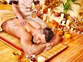 Woman getting bamboo massage. Royalty Free Stock Images