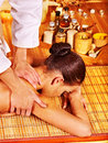 Woman getting bamboo massage young male therapist Royalty Free Stock Image