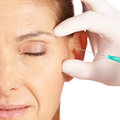 Woman getting crows feet removed Stock Photo