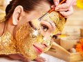 Woman getting  facial mask . Royalty Free Stock Photography