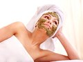 Woman getting facial mask in spa . Royalty Free Stock Photo