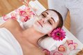 Woman getting facial mask at spa studio Royalty Free Stock Photo