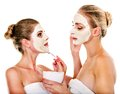 Woman getting facial mask young and gossip isolated Royalty Free Stock Images