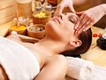 Woman getting  facial massage . Stock Photos