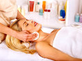 Woman getting facial massage blond head Stock Image