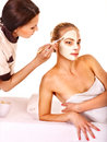 Woman getting facial massage white women mask in tropical beauty spa Royalty Free Stock Images