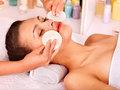 Woman getting facial massage young in beauty spa Royalty Free Stock Image