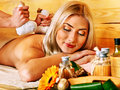 Woman getting herbal ball massage blond in spa Royalty Free Stock Photo