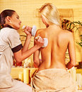 Woman getting herbal ball massage blond women in spa Stock Photography