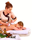 Woman getting herbal ball massage treatments in spa Stock Photos