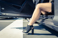 Woman getting out the car. Royalty Free Stock Photo