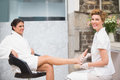 Woman getting a pedicure from beautician at the beauty salon Royalty Free Stock Images