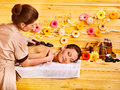 Woman getting stone therapy massage happy women in spa Stock Photo