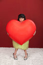 Woman With Giant Heart Stock Photography