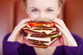 Woman with giant sandwich holding very big in her hands Royalty Free Stock Photos