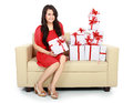 Woman with gift box in the couch Stock Images