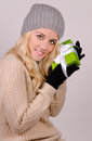 Woman with gift box holding a green at christmas Royalty Free Stock Photography