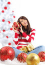 Woman with gift box next to christmas tree Stock Photography