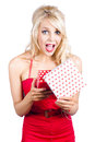 Woman with gift box a a a surprised look Royalty Free Stock Photography