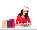 Woman with gift box and tablet pc computer christmas x mas online shopping concept in santa helper hat Stock Photography