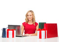Woman with gift boxes bags and laptop computer christmas x mas online shopping concept Stock Photography