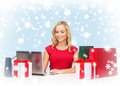 Woman with gift boxes bags and laptop computer christmas x mas online shopping concept Royalty Free Stock Photo