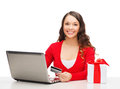 Woman with gift laptop computer and credit card christmas x mas online shopping concept box Stock Photos