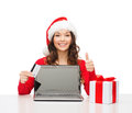 Woman with gift laptop computer and credit card christmas x mas online shopping concept in santa helper hat box Stock Image