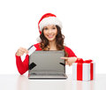 Woman with gift laptop computer and credit card christmas x mas online shopping concept in santa helper hat box Stock Images