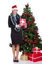 Woman with gift near christmas tree Royalty Free Stock Photos