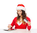 Woman with gift tablet pc and credit card christmas x mas online shopping concept in santa helper hat box computer Royalty Free Stock Photo