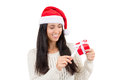 Woman gift wearing a santa hat holding a red with copy space Royalty Free Stock Photos