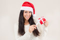 Woman gift wearing a santa hat holding a red with copy space Royalty Free Stock Images