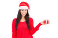 Woman gift wearing a santa hat holding a red with copy space Royalty Free Stock Photo